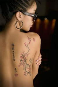Asian flower tattoo on girl's back