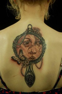 Girl face in Mirror Back Piece Tattoo