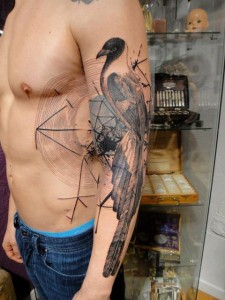 Intricate looking bird tattoo on guy