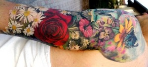Spring flowers sleeve tattoo wrapping around arm