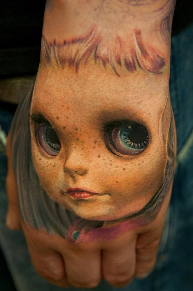 Awesome Doll Face Tattoo On Hand Cool Tattoos Online