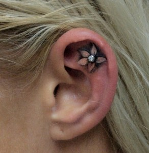 Cool Flower Ear Tattoo with Piercing