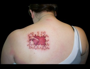Missing Puzzle Pieces Shoulder Tattoo