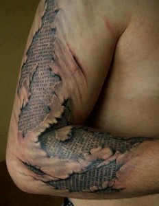 Ancient 3d writing on arm Tat