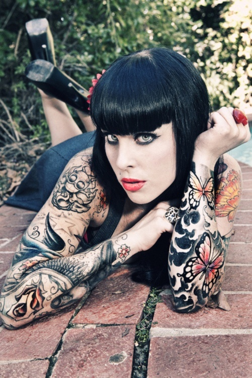 Sleeve tattoo for girls with black hair