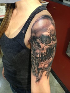 Dead Skull Tattoo on Girl Arm