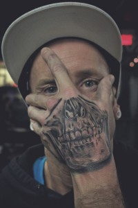 Hand Over Face Skull Tattoo