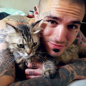 Tattoo Guy with a Cat Pet