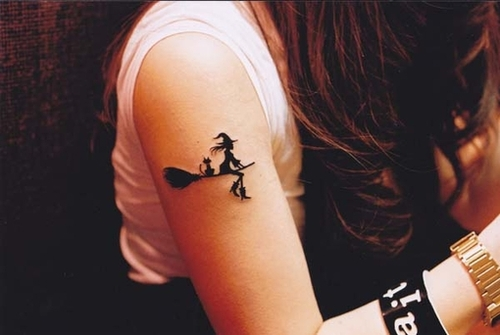 Witch flying on broom with cat tat