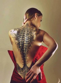Alien skeleton 3d tat on girl's back